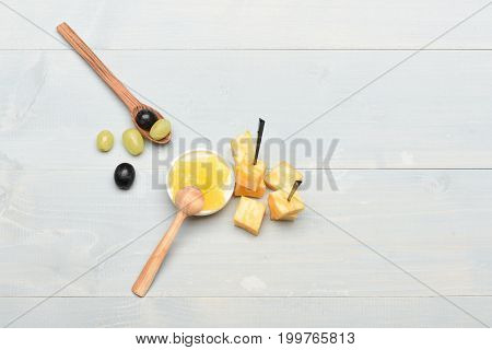 Composition Of Marble Cheese Skewers, Honey And Grapes