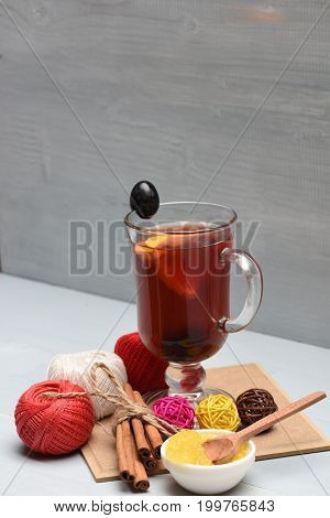 Mulled Wine, Yarn Balls And Bunch Of Cinnamon Sticks