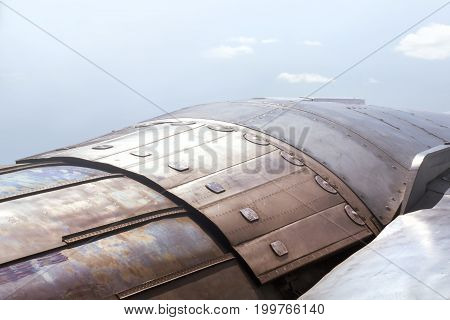 Future technology background. Element of spacecraf metal casing. Thrust vectoring engine close up.