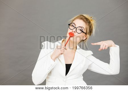Happy Elegant Woman Holding Carnival Accessoies On Stick