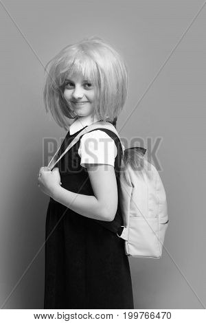 Girl With Backpack In Light Color. Kid With Happy Face