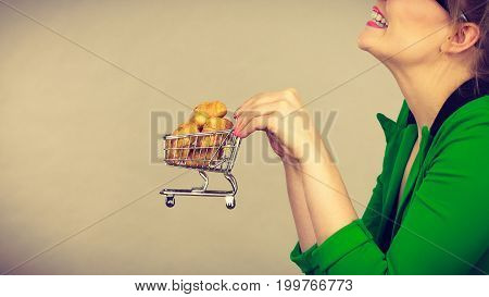 Woman Hand Holding Shopping Cart With Bread