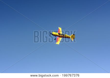 Sport aircraft air show pilotage. Small airplane in the sky