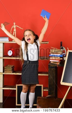 Back To School And Education Concept. Girl Holds Book