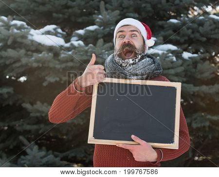 Excited Santa With Blank Chalkboard