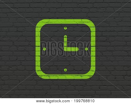 Time concept: Painted green Watch icon on Black Brick wall background