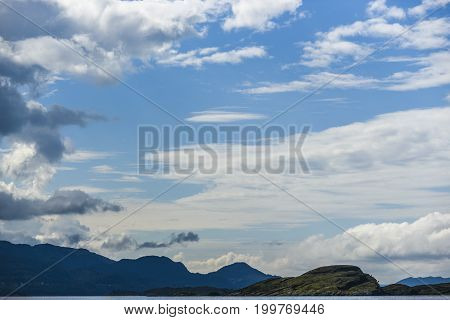 Beautiful landscape on the north sea in norway with clouds on a sunny day