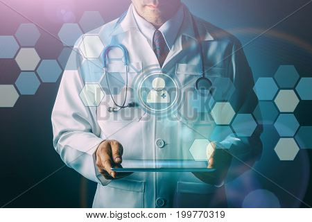 Doctor with stethoscope and tablet computer on black background still life style Technology digital to treat patients concept.
