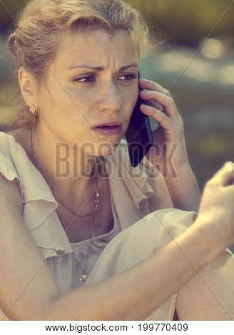 A frustrated girl speaks on the phone.