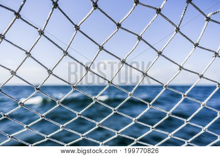 A material net that is a decoration on a yacht performing protective functions. Texture or background.
