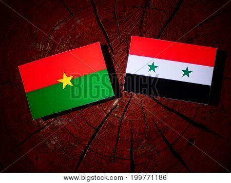 Burkina Faso Flag With Syrian Flag On A Tree Stump Isolated
