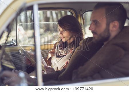 Young couple on a road trip enjoying the sunny day and having fun