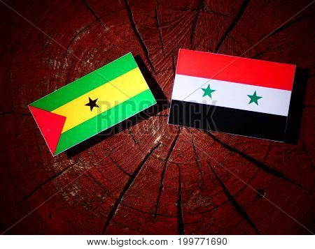 Sao Tome And Principe Flag With Syrian Flag On A Tree Stump Isolated