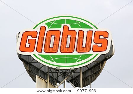 Cologne, Germany - July 1, 2017: Globus logo on a panel. Globus is a German retail chain of hypermarkets, DIY stores and electronics stores