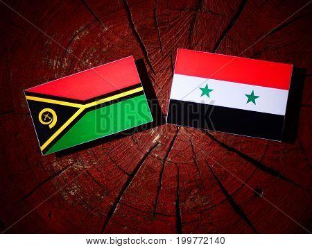 Vanuatu Flag With Syrian Flag On A Tree Stump Isolated