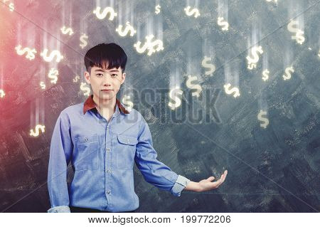 business of finance concept - young man stretched out his hand to the side For money falling like rain currency dollars.