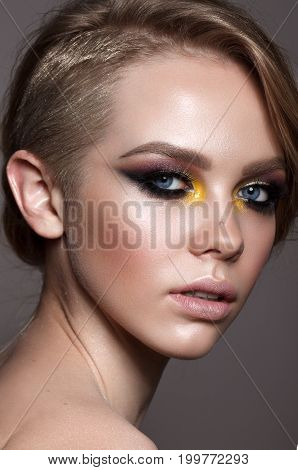 Beautiful young model with fashion make up, perfect skin. Trendy colorful smoky eyes.