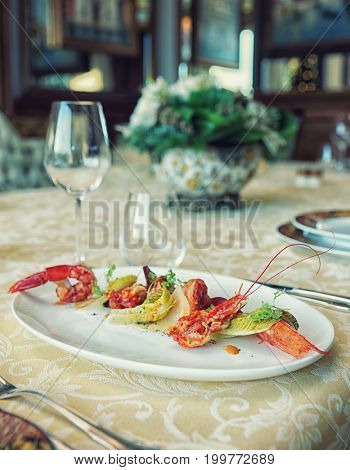 Red shrimp appetizer in an expensive restaurant, toned image