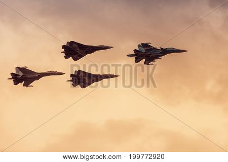 Moscow Region - July 21, 2017: Modern Russian strike fighters Sukhoi Su-35 Su-34 and two newest Su-57 (T-50 PAK FA) at the International Aviation and Space Salon (MAKS) in Zhukovsky.