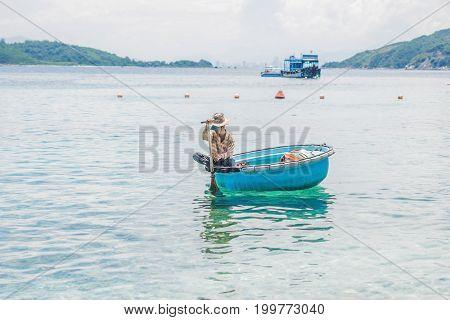 Nha Trang VIETNAM - MAY 19 2017: Fisherman in a Vietnamese boat like basket.
