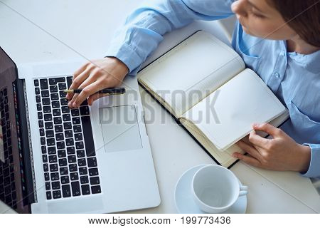 Woman working at computer in office, business.