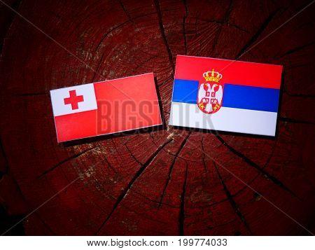 Tonga Flag With Serbian Flag On A Tree Stump Isolated