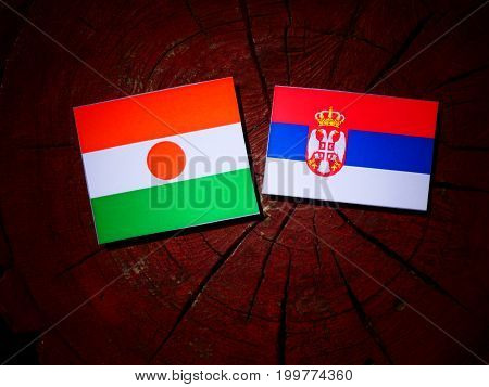 Niger Flag With Serbian Flag On A Tree Stump Isolated