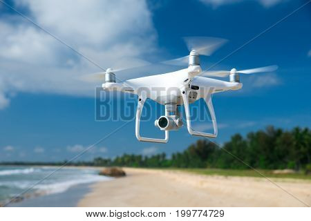 drone flying over sea.