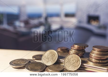 Credit cards and euro coins on a light wooden table