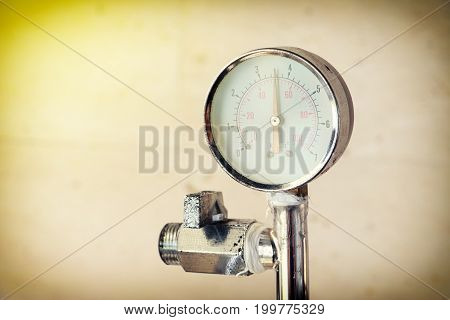 Pressure gauge measuring instrument close up on vintage background. Hydraulic pressure gauges equipment with copy space for text. Pressure measurement concept.