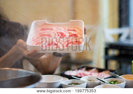 Raw Sliced Beef for Shabu Shabu. Plate  sliced raw beef for japanese shabus habu