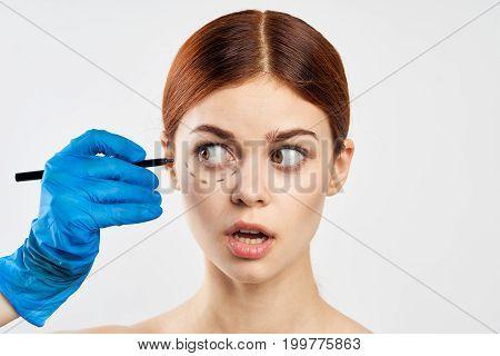 Woman on white background, outline, face, portrait, plastic surgery.