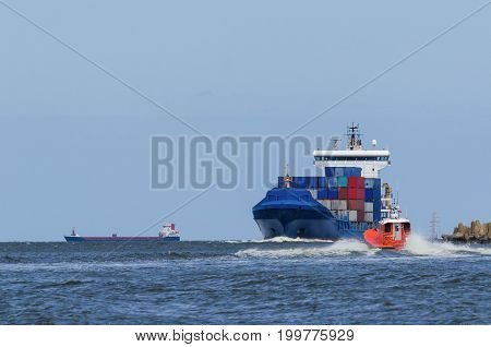 CONTAINER SHIP AND PILOT BOAT - Shiping traffic near the port