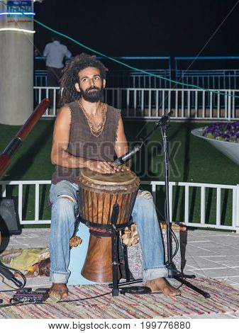 Nahariya Israel August 14 2017 : A young guy plays a darbuka in the evening on the waterfront in the city of Nahariya in Israel
