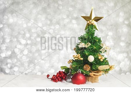 Christmas Tree With Cherry And Ball Decorate On White Fur With Blue Silver Bokeh Sparkle Light Backg