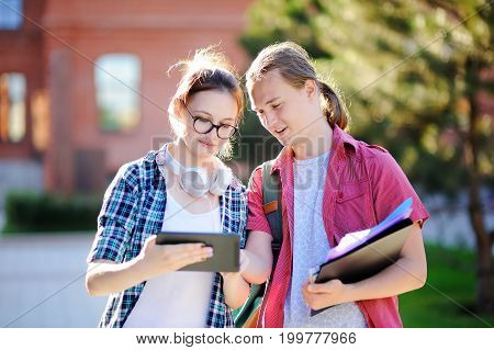 Young Happy Students With Books And Notes In University Campus