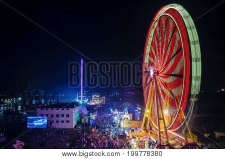 SZCZECIN, WEST POMERANIAN / POLAND: Final Tall Ships Races. Ferris wheel on the harbor quay at night