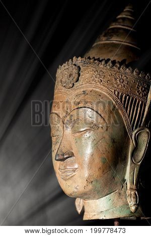 Enlightenment. Spiritual image of a buddha head in a beam of light representing wisdom and an epiphany awakening moment.