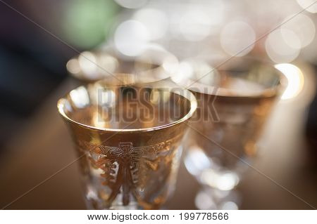 Three golden glasses in the defocus close-up