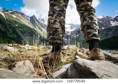 hikers go along mountain ridge. Tourist on the background of beautiful mountain scenery. Siberia Altai Russia. The concept of Hiking in the wild.