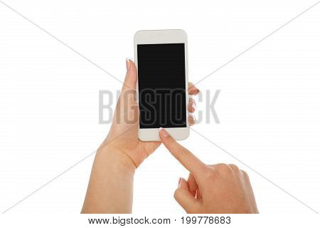 Female hand pointing on mobile phone blank screen isolated on white background, close-up, cutout, copy space on the screen
