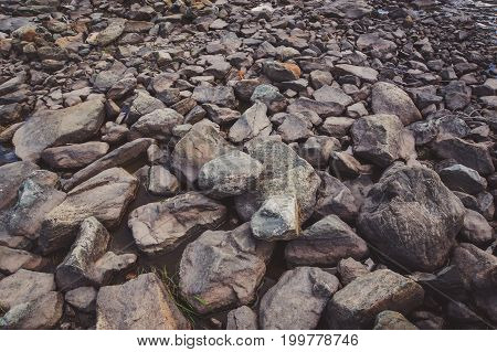 Smooth Stones In The River In The Background.