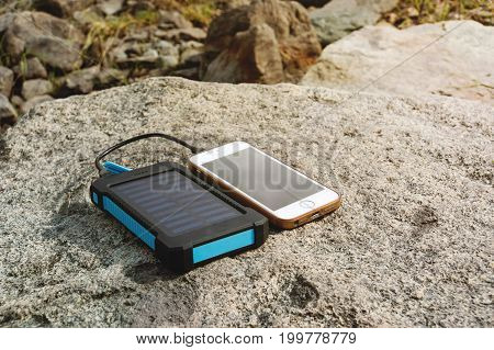 Battery Solar Energy Device On The Stone.