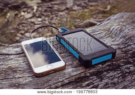 Solar Power Bank Charging Smart Phone