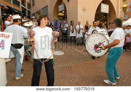People Performing Gugge Music At The Carnival Of Lugano