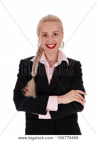A beautiful young blond businesswoman standing in a black jacket and oink blouse with braided blond hair isolated for white background