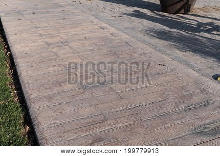 stamped concrete pavement outdoor, Wooden slats pattern, cement flooring exterior decorative texture of cement paving