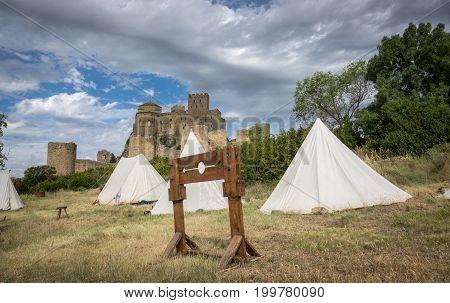 Castle of Loarre and surroundings, Hoya de Huesca Loarre Aragon Huesca Spain, settlement on a Medieval reenactment demonstration and recreation poster