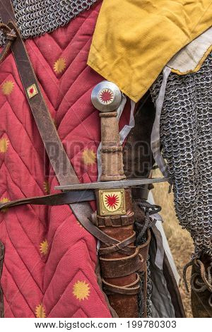 Medieval sword hilt detail, chainmail, sword and shields a medieval armor knight ready for battle detail