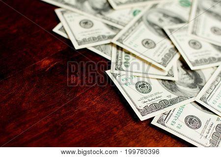 Background With Money American Hundred Dollar Bills On Desk